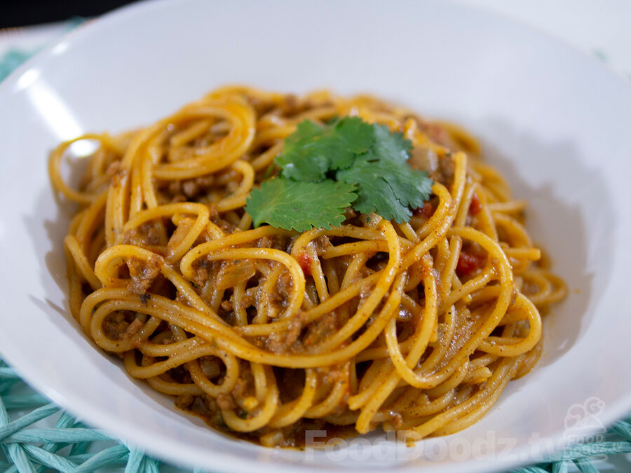 Tasty bowl of Tex-Mex Taco Spaghetti topped with cilantro leaves