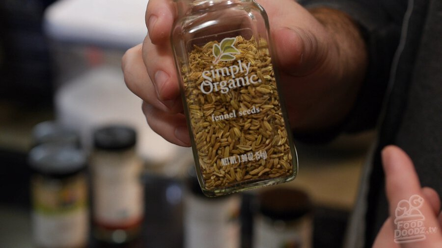 Jar/container of fennel seeds seasoning/spice