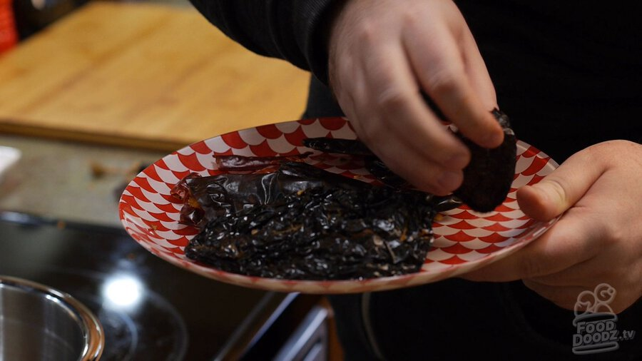 Turning over plate of dried chilies after 45 secs in microwave (New Mexico Chiles, Ancho, Arbol)