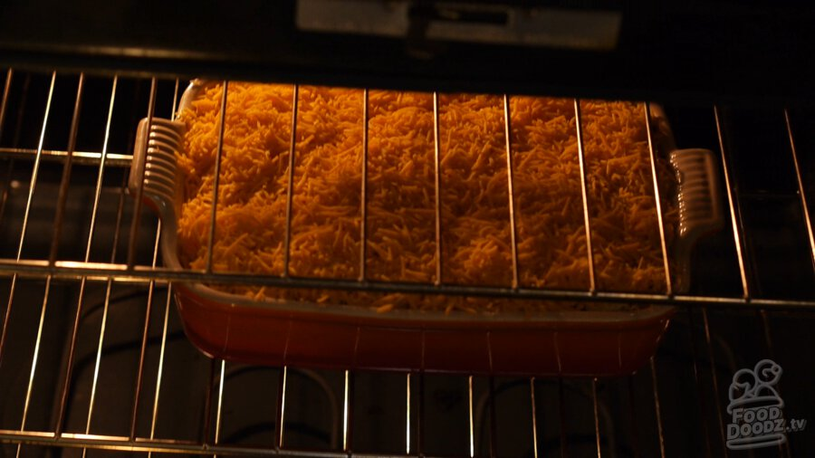 Hashbrown casserole being placed in the oven