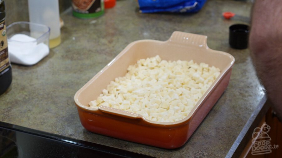 Frozen hashbrowns added to baking dish