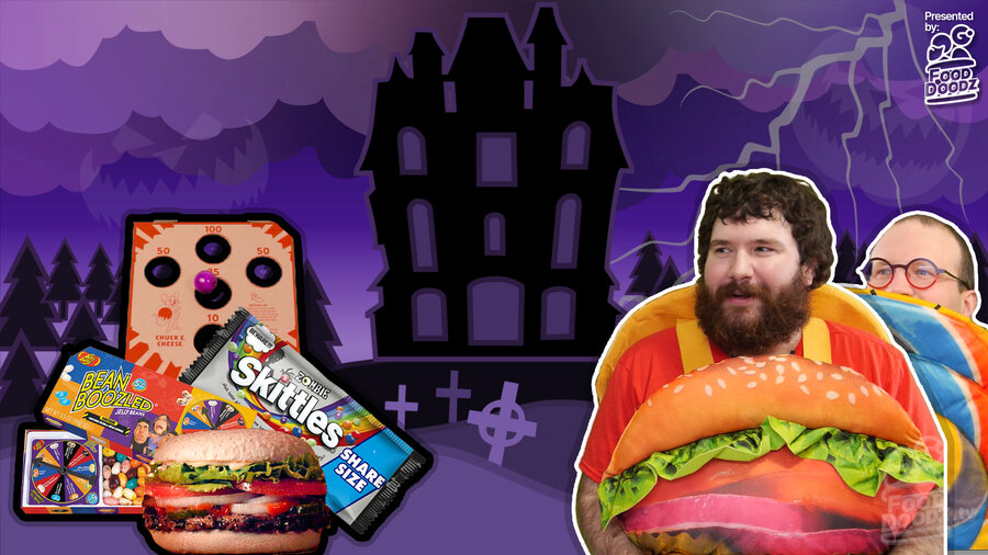 Adam (man) wearing cheeseburger Halloween costume stares lovingly at assorted candy and food with haunted house in background