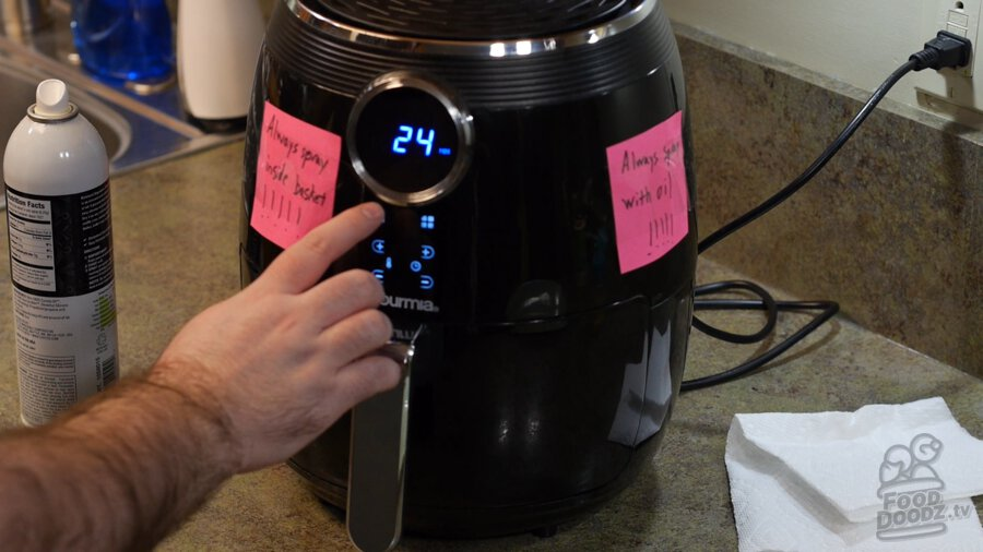 Setting the air fryer timer for 24 minutes