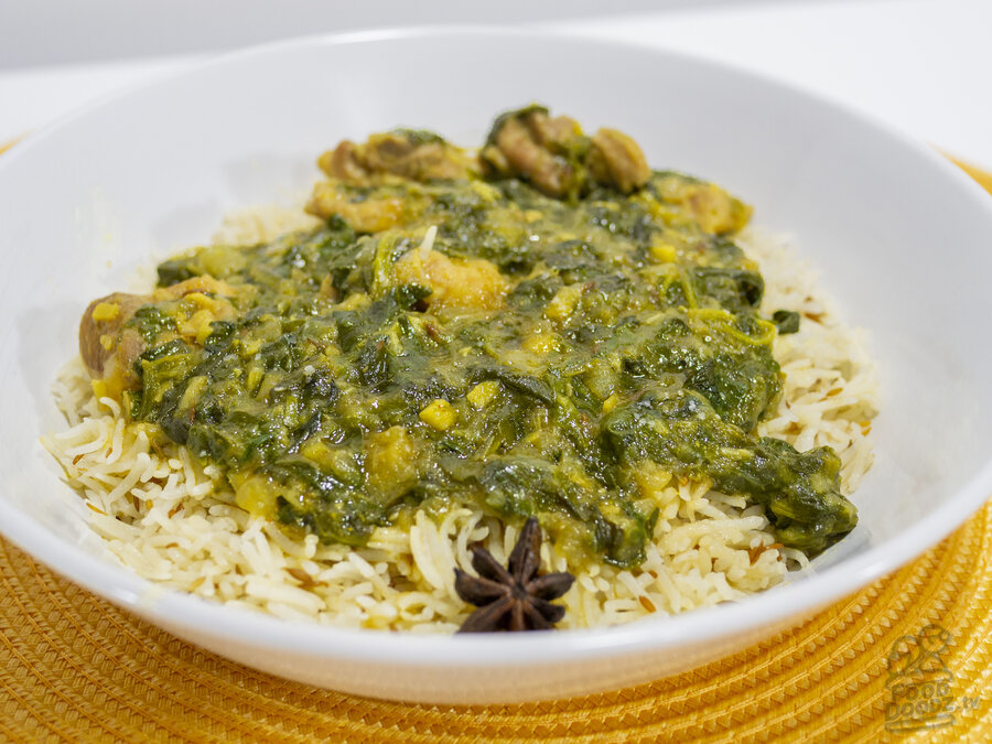 A delicious bowl of Indian Chicken Saag over cumin rice.