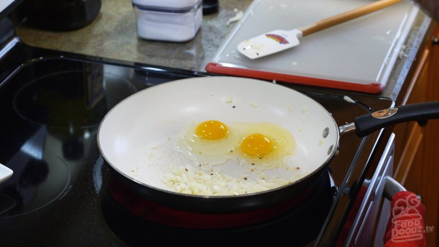 Adding eggs to pan