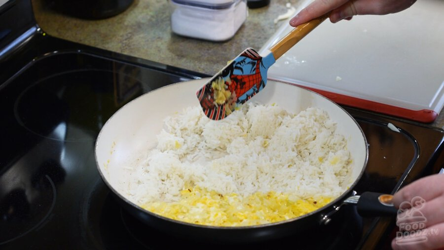 Adding rice to pan