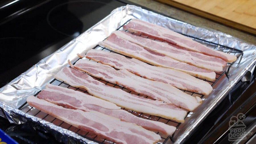 Lining baking sheet with bacon slices