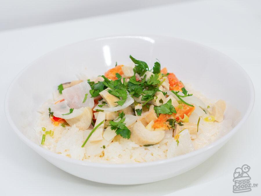 A big bowl of delicious Spicy Thai Coconut Chicken Soup (Tom Kha Gai).