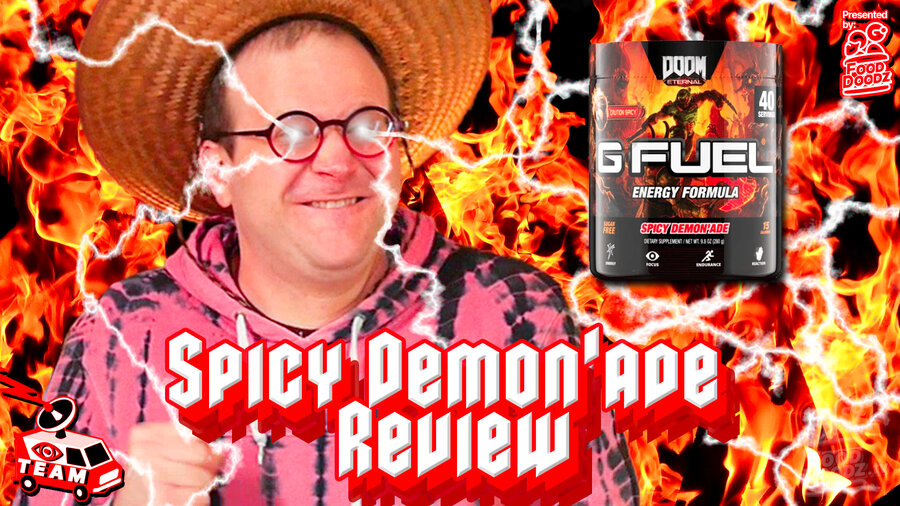 Man wearing bright pink hoodie and straw hat makes intense face with glowing eyes and lighting bolts shooting out of his eyes. Flames are behind him and he's looking at a tub of GFUEL Spicy Demonade energy drink.