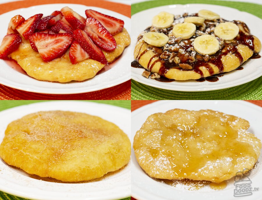 A table filled to the brim with Indian Fry bread topped with various sweet dessert toppings.