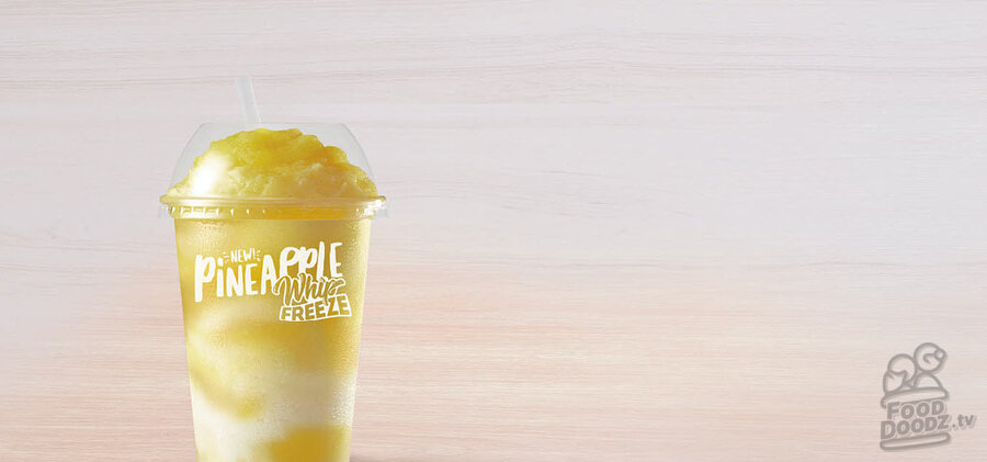 Taco Bell Pineapple Whip Freeze stock photo from their website