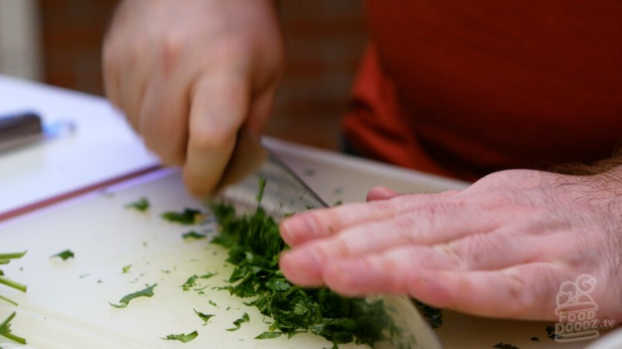 Finely chopping cilantro
