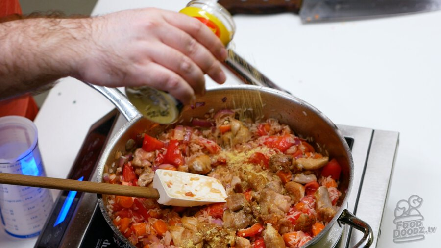 Adding chicken bouillon powder to the pan