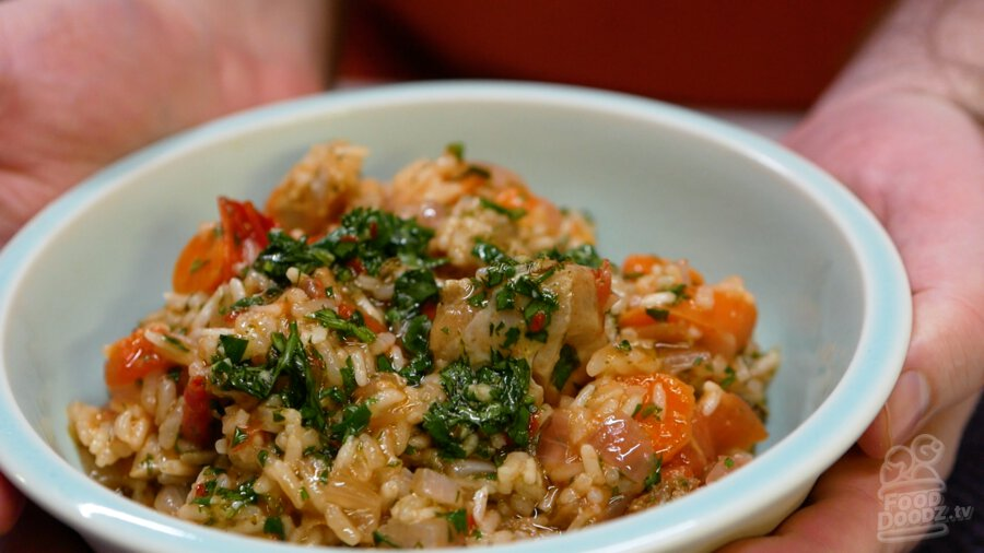 A bowl of the delicious chimichurri chicken rice