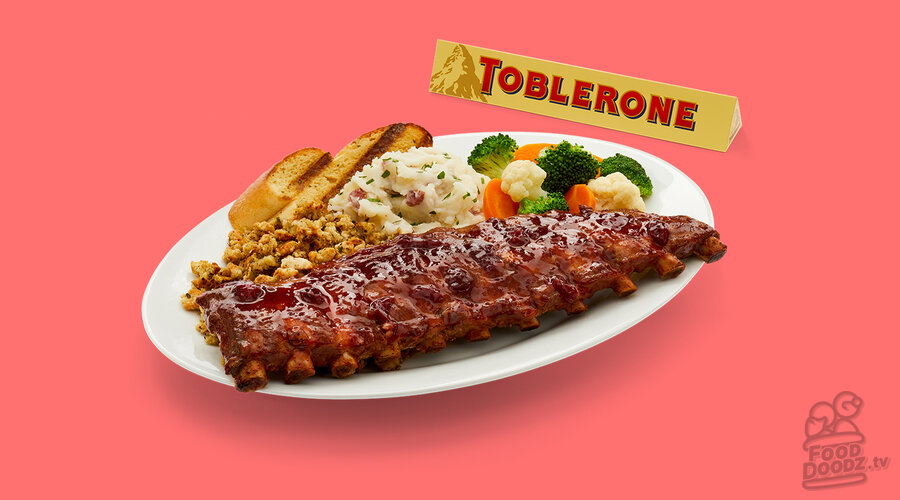 Colorful Christmas dinner themed ribs from Boston Pizza. glazed with cranberry BBQ sauce. Then served along-side house-made (do they really make this in the shop?) stuffing, steamed vegetables, turkey gravy, garlic, toast, and another side